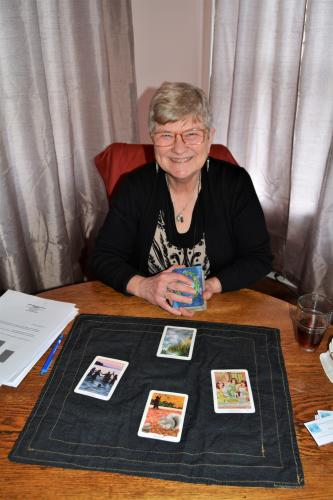 Tarot card reader at Mouzon with cards laid out in front of her