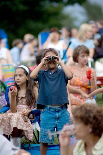 Crowd and child with binoculars c Saratoga Photography Assoc