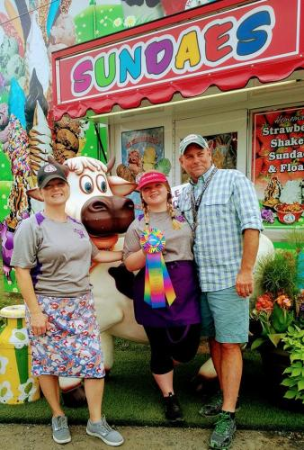 Saratoga Co. Fair family posing by sundae stand