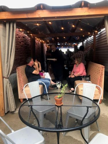 Group sitting in outdoor patio space at Taverna Novo