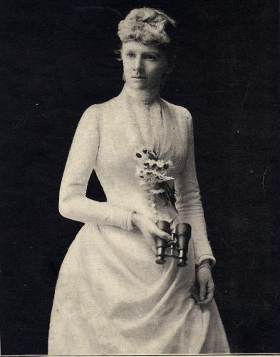 Old photo of Reubena Walworth dressed in white and holding flowers