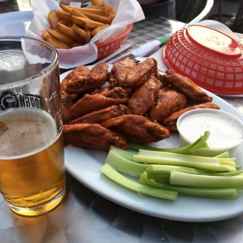 Wings from Three Dollar Cafe in Sandy Springs go great with a refreshing pint of cold beer