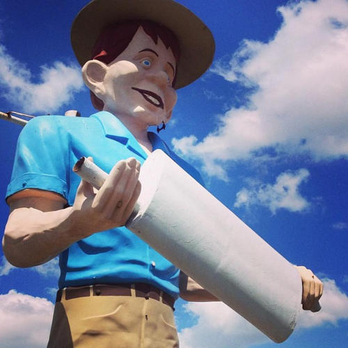 Happy Half-Wit Muffler Man stands against the sky in Beaumont, TX