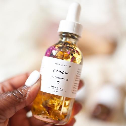A bottle of Renew - Intention Oil by the Dayton-based Mint & coco wellness company.