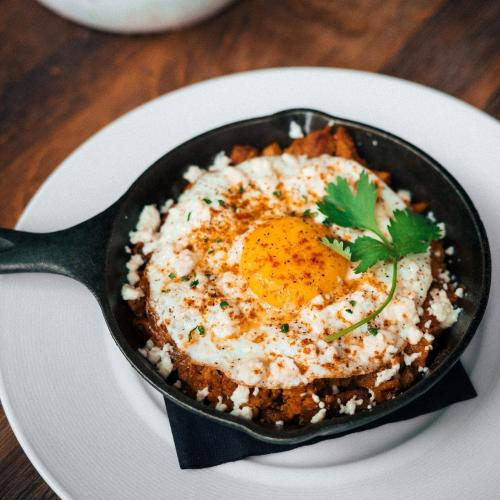 Eggs in a cast iron pan at Table 33 in Dayton, OH