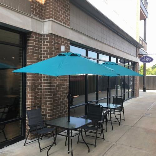 two patio tables outside of Saratoga Broadway Deli in Saratoga Springs