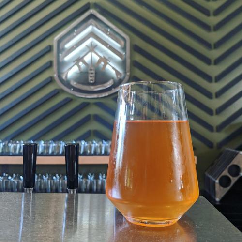 orange-y beer in a glass