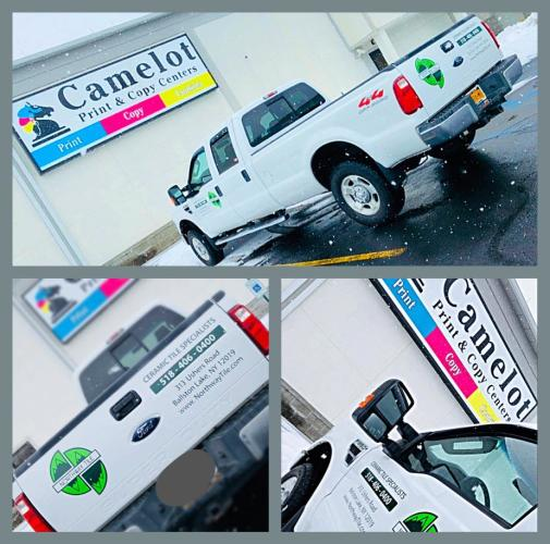 Camelot truck and sign