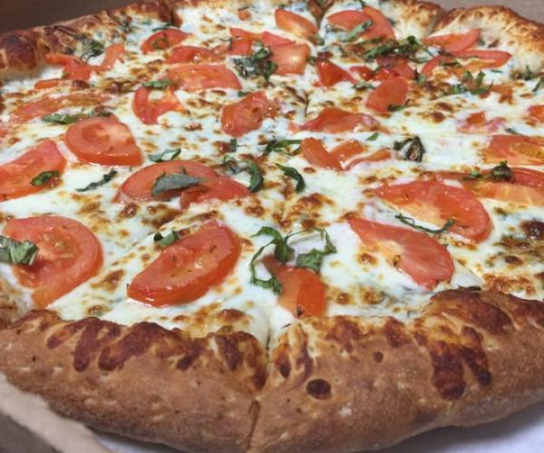 Margherita pizza at Pizza Parlor in Sugar Land, TX.