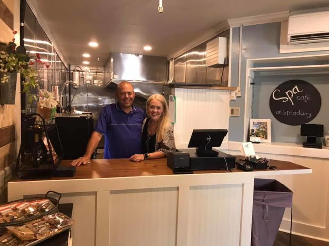 Owners of Spa Cafe on Broadway posing behind the counter