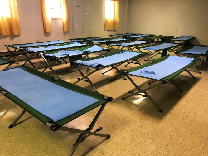 Room filled with clean cots