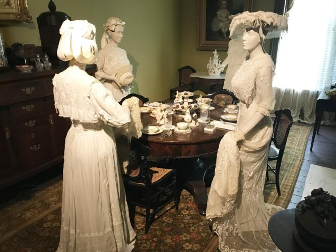Walworth Mansion exhibit with three women standing in dining room
