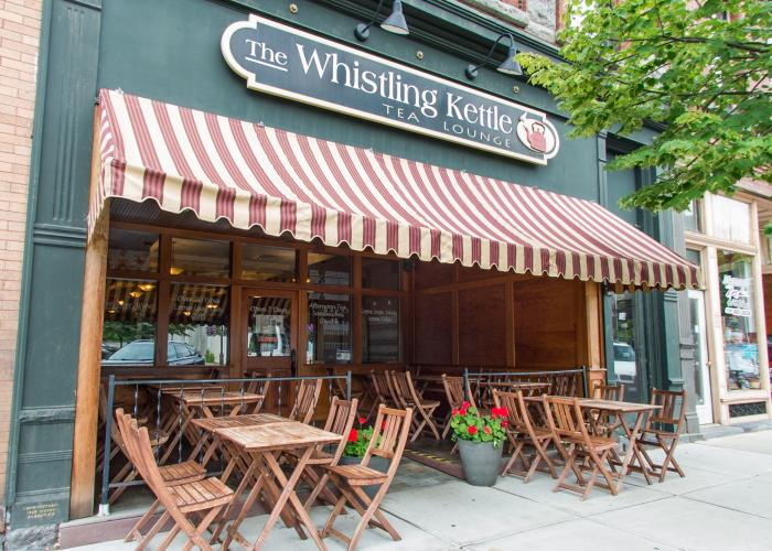 Exterior shot of The Whistling Kettle with outdoor seating in Ballston Spa, NY