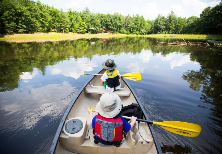 Explore Montfair's small mountain lake with canoes