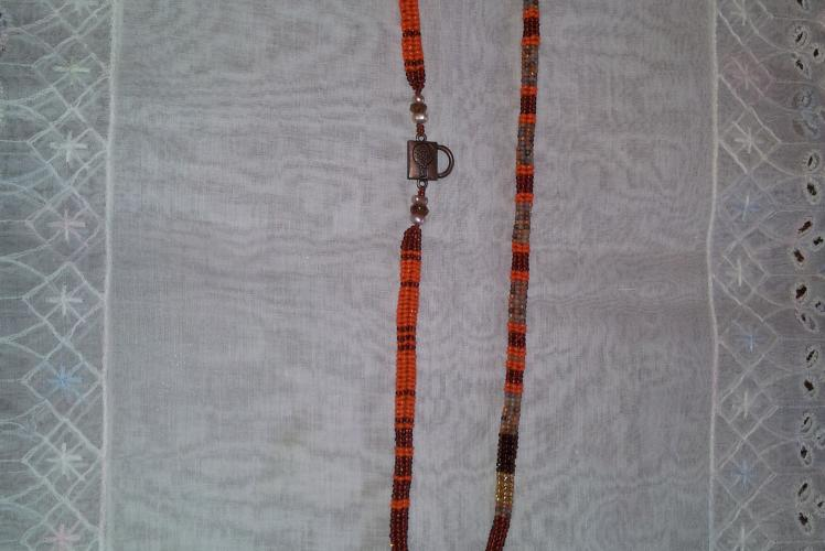 beaded necklace with a fall feel to it.  Old keys and a magnetic key clasp