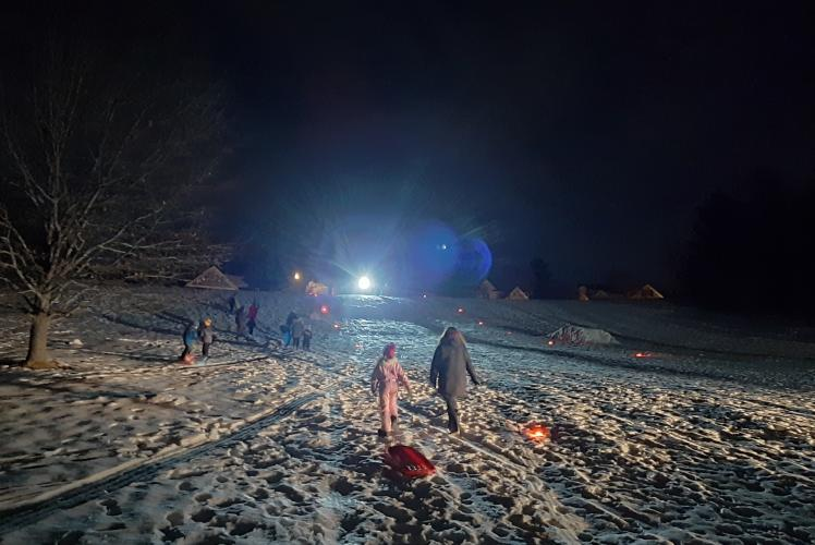 Sledding at Jelly Bean Hill on Community Glow Night