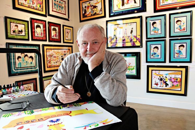B- Framed: guy and art behind him
