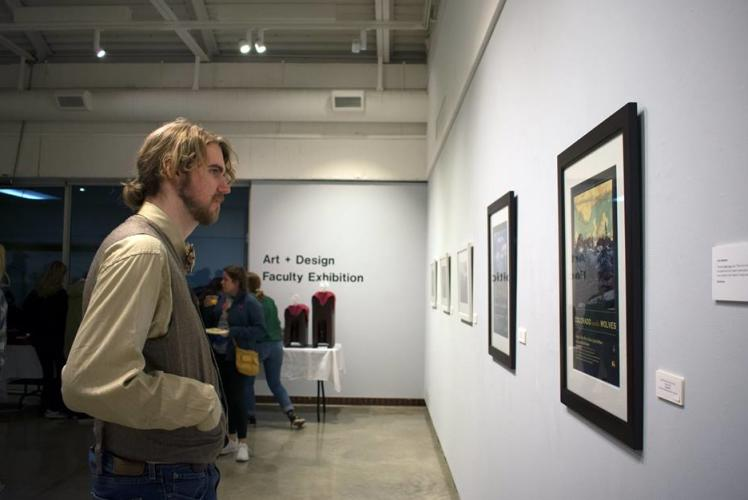 UW- Eau Claire Foster Art Gallary: man looking at art