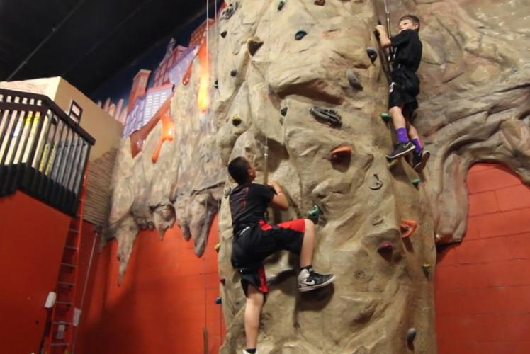 Action City Trampoline Park & Fun Center climbing wall
