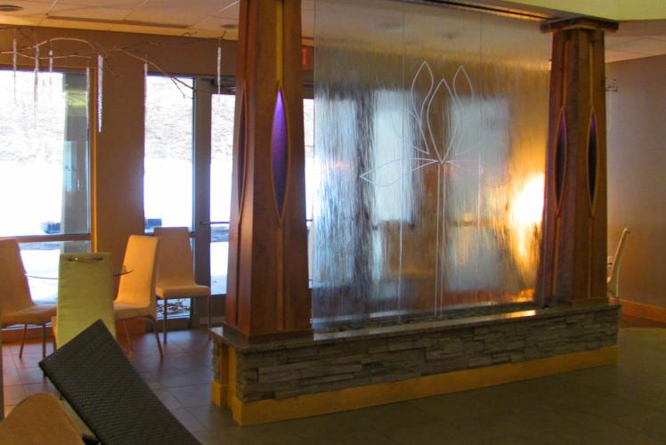 Lotus Spa waterfall feature and bistro seating in Eau Claire, WI