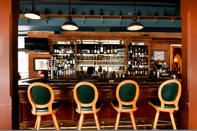 Inn at Saratoga Bar shot with four green stools