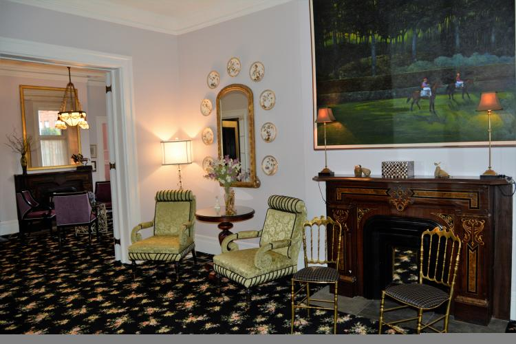 Saratoga Arms parlor with fireplace and large painting