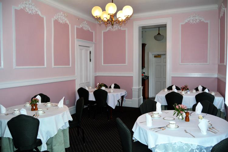 Saratoga Arms pink dining room with tables with white tablecloths