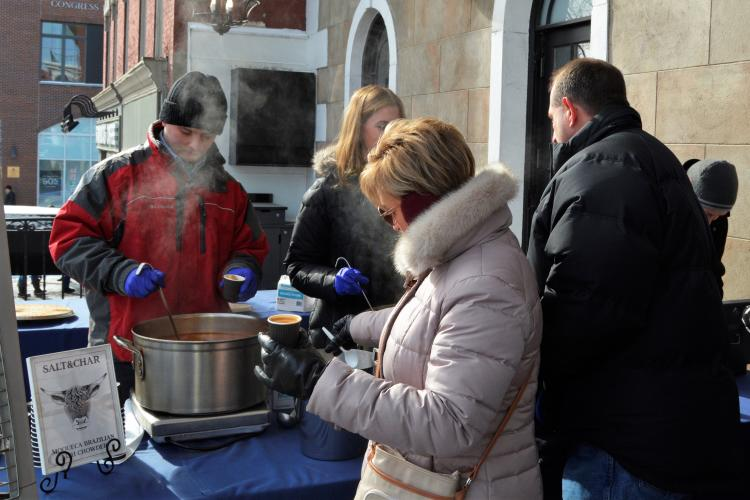 Chowder at Salt & Char being served to a woman in line