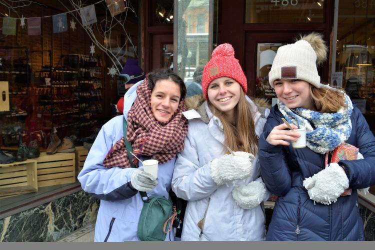 Three girls holding chowder