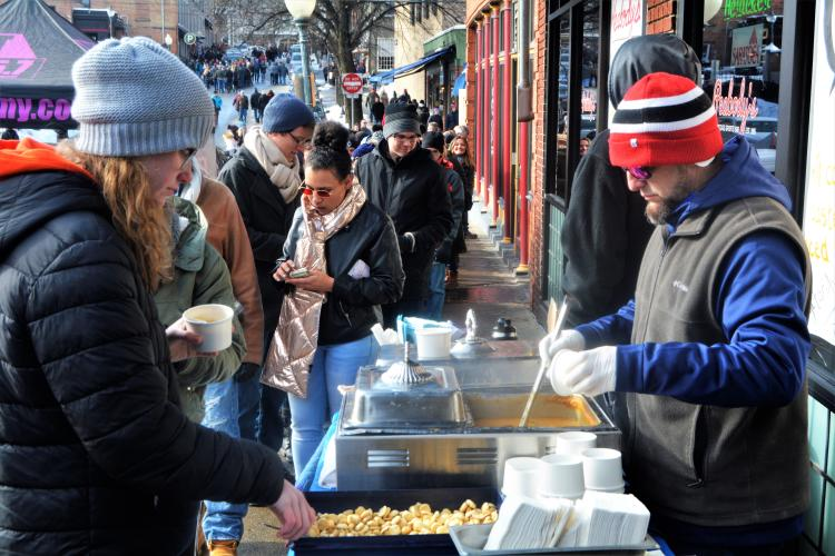 Peabody's serving chowder to a line of Chowderfest attendees