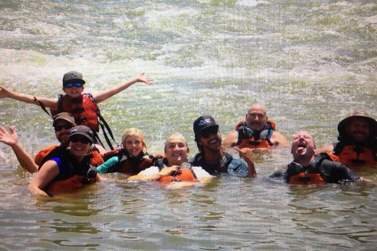family of 9 floating in river
