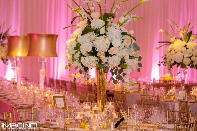 Karen & Company Event Planning reception table setting with large floral centerpieces and pink background draping