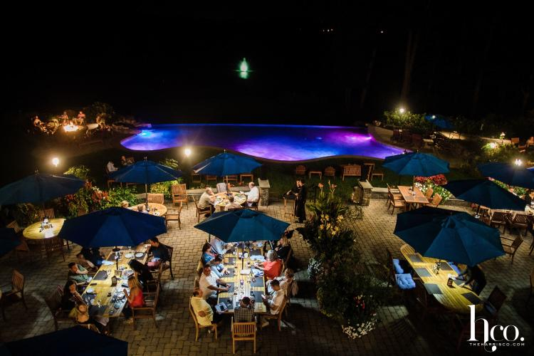 Nightime shot of the patio and pool at Prime at Saratoga National Golf Club