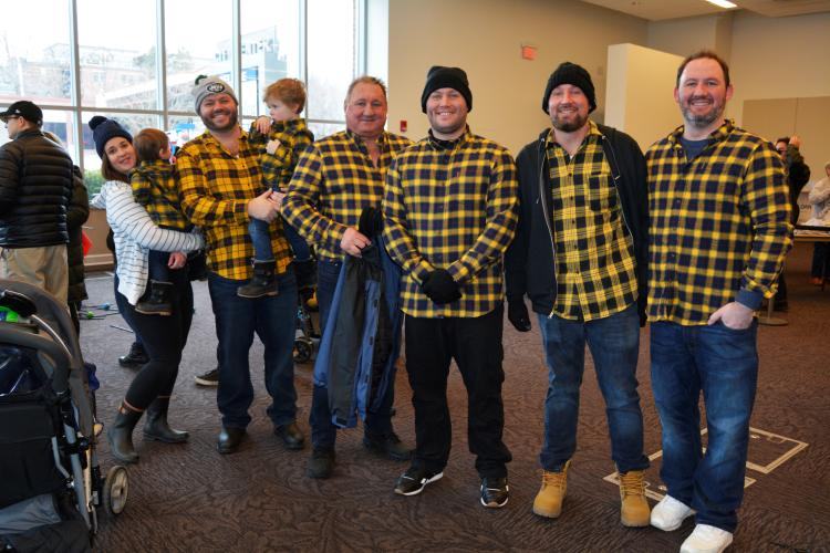 Group of 5 men and 2 boys dressed in yellow plaid