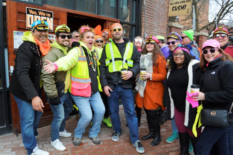 People dressed in neon clothing posing