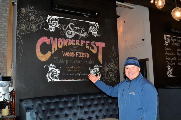 Darryl in front of Chowderfest sign at Seneca