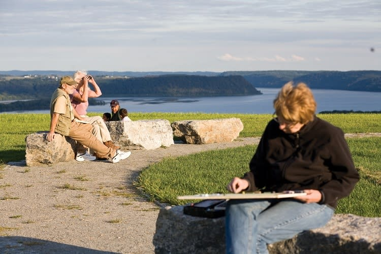 Woman Painting While Couple Enjoys View at Highpoint Scenic Vista