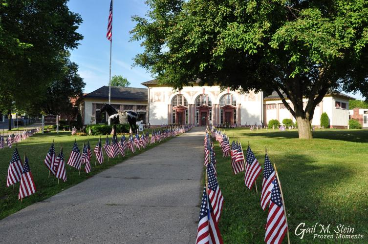 Saratoga Springs Visitor Center with rows of flags in the front