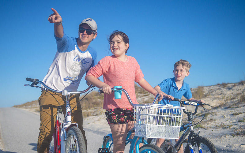 Family biking on Gulf Islands National Seashore