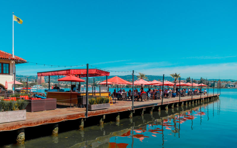 Lake Chalet dining on the water under shade umbrellas