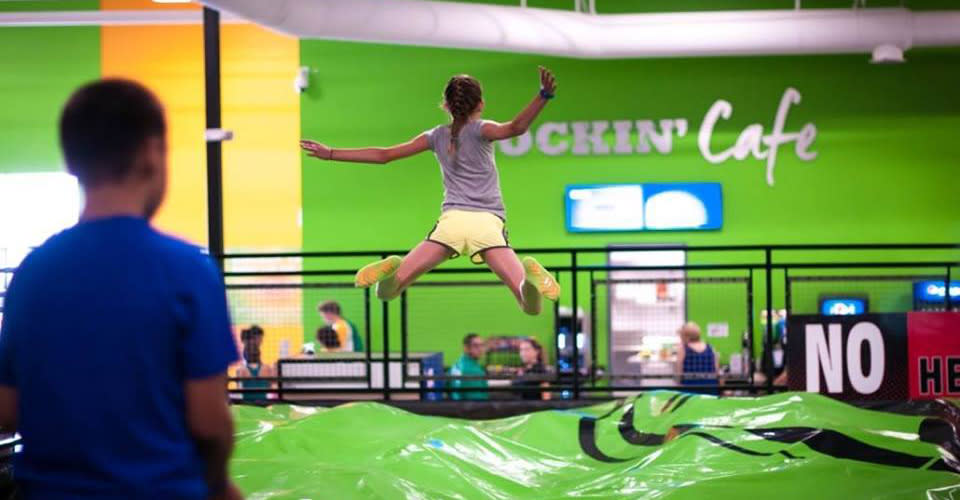 Girl jumping on trampoline at Rockin' Jump