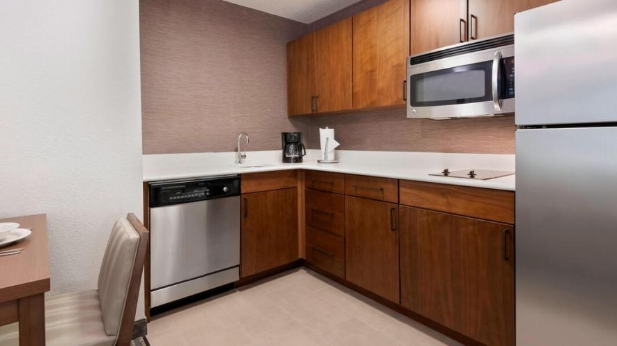one bedroom and studio kitchen area
