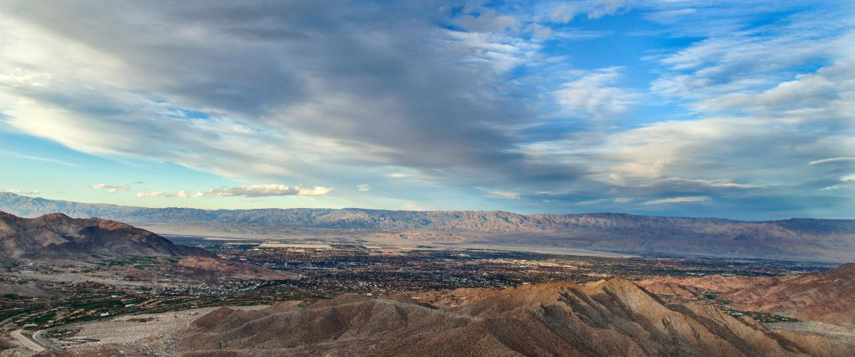 Beautiful clouds and blue sky surround the vista of Greater Palm Springs.