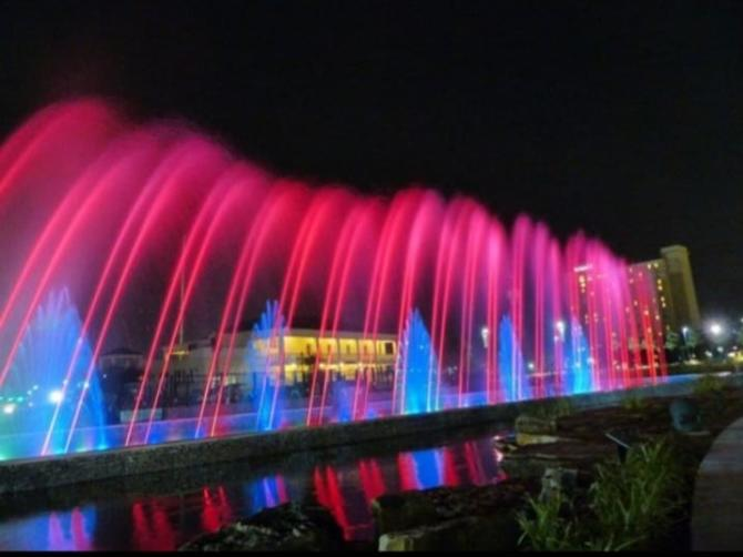 Colorful fountain display during the Night at the fountain event in Wichita