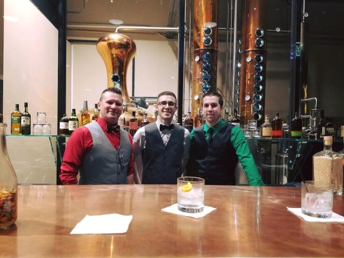 Bar tenders post at wheat state distilling in old town wichita ks
