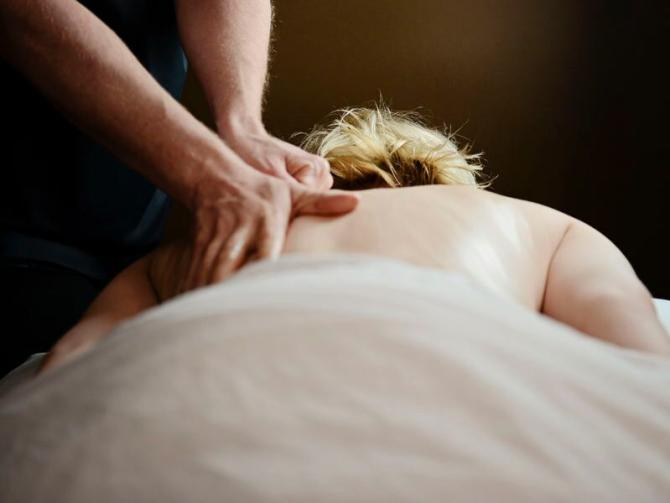 A woman gets a massage at Healing Waters in Wichita