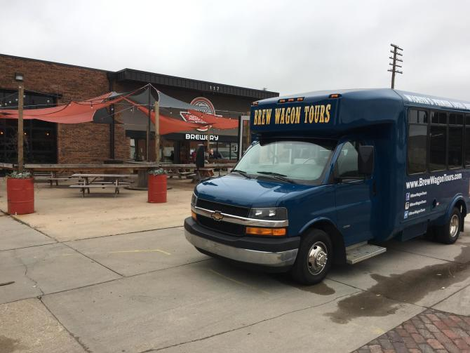 The Brew Wagon Tour bus waits for tourists outside of a Wichita brewery