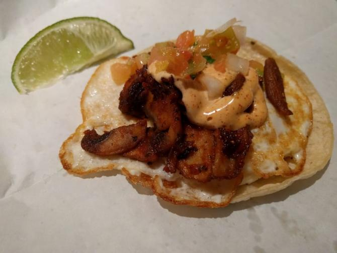 A single street taco with fried egg from District Taqueria in Wichita