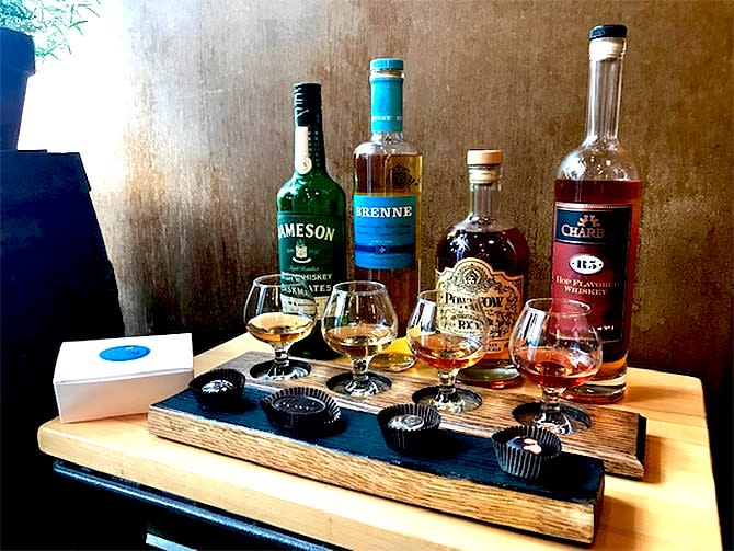 A tray of whisky and chocolate are served at Monarch in Wichita