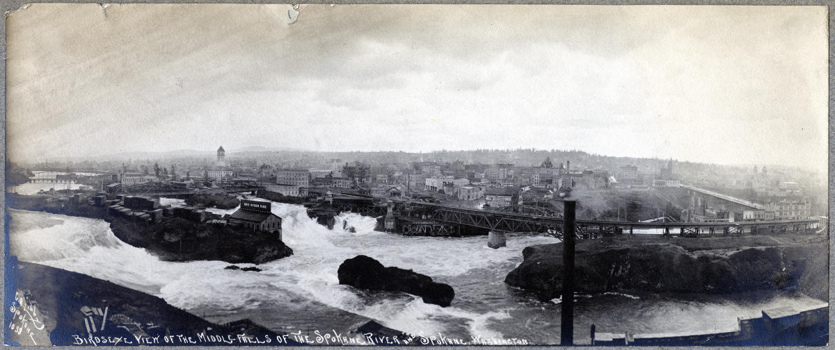 Historic birdseye view of the Spokane Falls taken in the early 1900s. You can see some mills, the framework for the Monroe Street Bridge and the early downtown core.